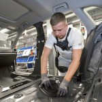 The ergonomic aid supports employees in production and logistics when lifting and carrying heavy materials. An Audi employee wears the exoskeleton to relieve the back muscles when installing the interior trim during A4/A5 assembly at the Ingolstadt plant.
